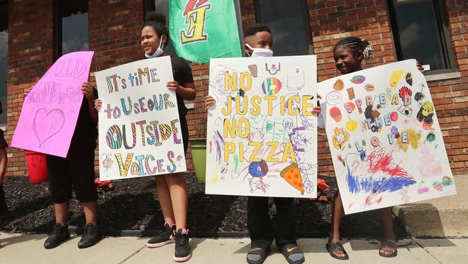 Children from the Little Leaders Child Enrichment Center protest in front of their daycare during their Kiddie Protest Bake Sale fundraiser for the family of George Floyd Friday June 5, 2020 in Akron, Ohio. The baked goods were donated by staff, students' family members and through people offering to help on social media.