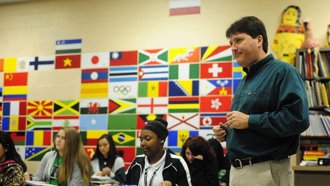 Rodolfo Espinoza is the president of the Lafayette Parish Association of Educators. He is seen teaching in his classroom at Lafayette High in 2014.