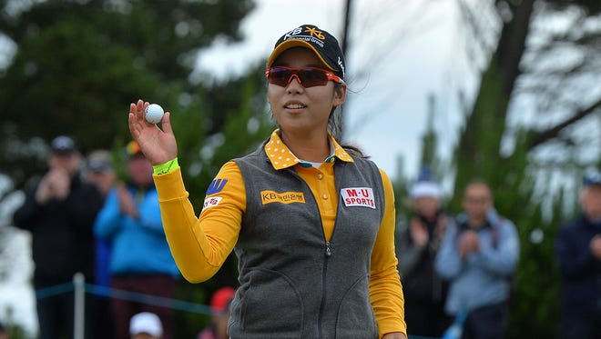 Lee of Korea waves to the crowd at the 18th green as she finishes her final round at Ladies Scottish Open.