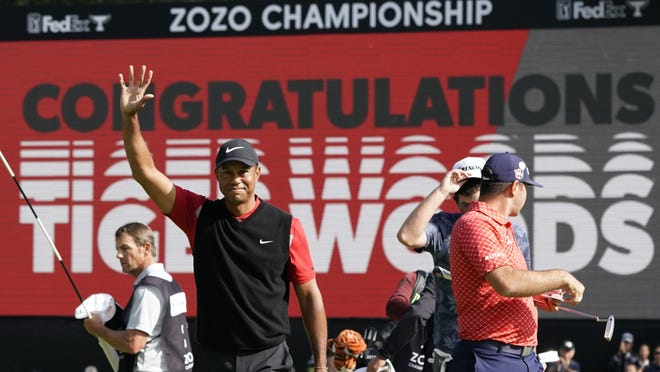 Tiger Woods celebrates after winning the Zozo Championship golf tournament last year at the Accordia Golf Narashino country club in Inzai, east of Tokyo, Japan. Woods is the defending champion at a course where he has won five times.