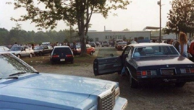 In this 1980s photo, the Sunday morning sun rises on the crowd leaving the Famous Kingfish club on the Lake Martin Road.