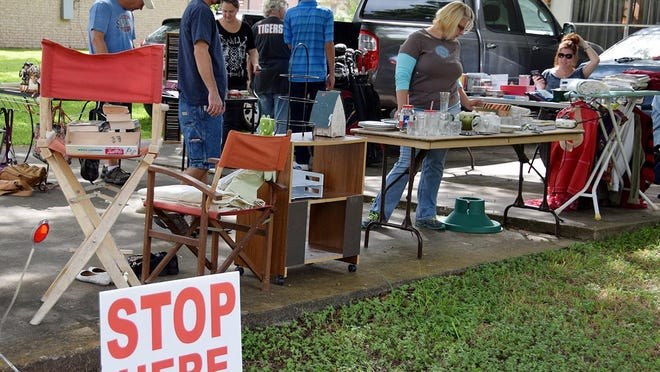 Home across Smithville hold garage sales as part of the community-wide garage sales hosted by the Smithville Chamber of Commerce.