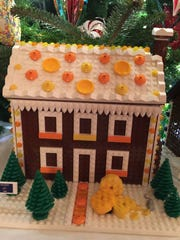 A gingerbread house made by Lego represents the state of Wisconsin in the State Dining Room at the White House.