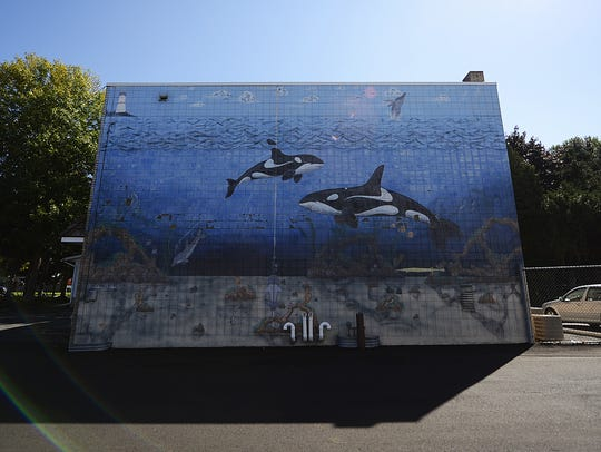 A whale mural decorates the side of John Otis' American