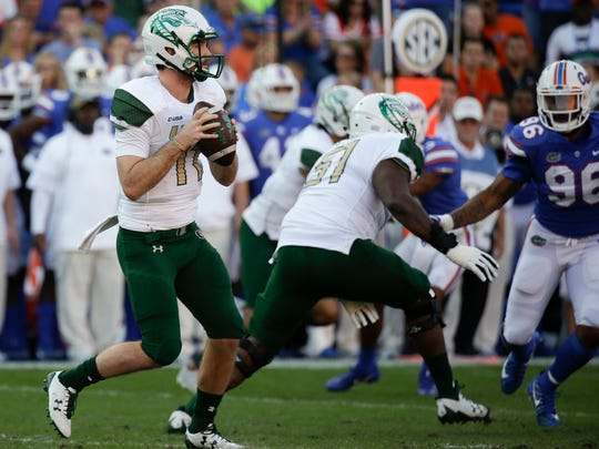UAB quarterback A.J. Erdely (11) looks for a receiver as he is rushed by Florida defensive lineman Cece Jefferson (96) during the first half of an NCAA college football game, Saturday, Nov. 18, 2017, in Gainesville, Fla. (AP Photo/John Raoux)