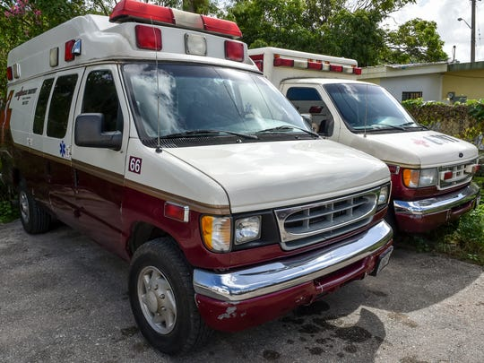 Medical transport trucks parked outside the Guam Medical Transport office in Tamuning are shown in this Dec. 31, 2015, photo.
