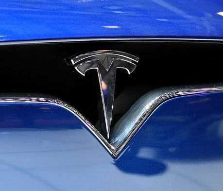 Auto analyst drops 'buy' rating for Tesla