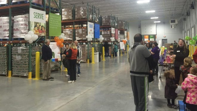 Feeding America representatives welcomed the public to the grand opening of its new Appleton food bank on Oct. 31.