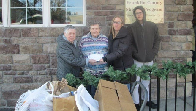 Shook Home residents deliver donations to the Franklin County Homeless Shelter. Left to right are Shook residents Shirley Baker and Jackie Peters; Karen Riley, site coordinator for SCCAP at Franklin County Shelter;  and Kyle Turk, shelter client.