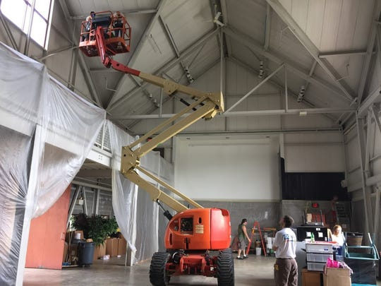 Work began in mid-July to convert a former museum exhibit space into George Street Playhouse's new theater at its interim College Farm Road venue.