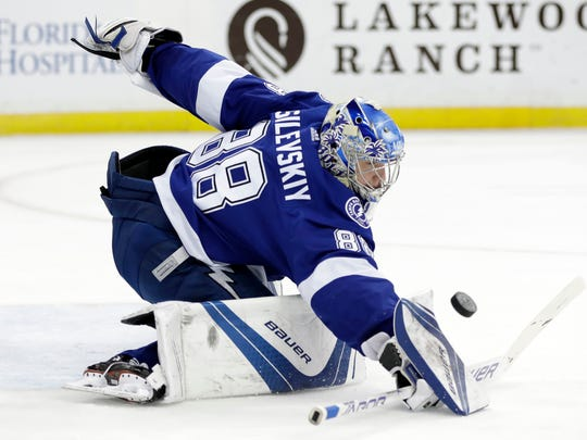 Tampa Bay Lightning goaltender Andrei Vasilevskiy (88) makes a blocker save on a shot by the Buffalo Sabres during the first period of an NHL hockey game Friday, April 6, 2018, in Tampa, Fla. (AP Photo/Chris O'Meara)