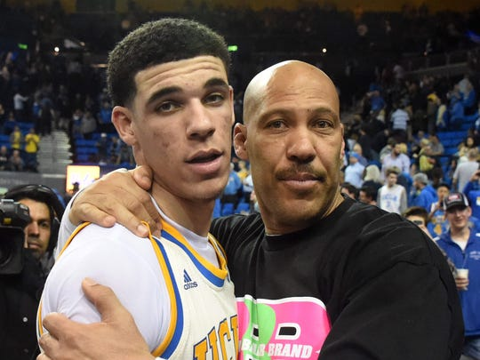 Lavar Ball embraces his son Lonzo Ball after a UCLA