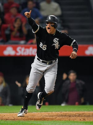 Chicago White Sox's Avisail Garcia celebrates after scoring on a single by Todd Frazier during the ninth inning against the Los Angeles Angels, Tuesday, May 16, 2017 in Anaheim, Calif.