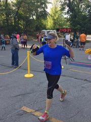 Jennifer Clark of Brandon finishes a race as she continues