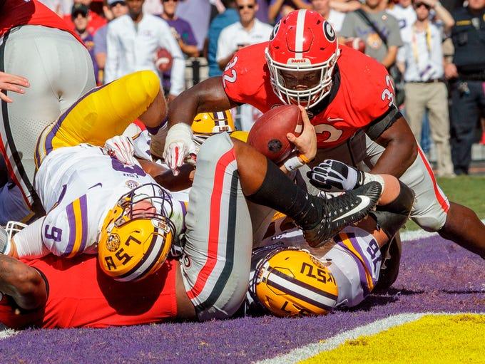 LSU quarterback Joe Burrow (9) scores a touchdown during