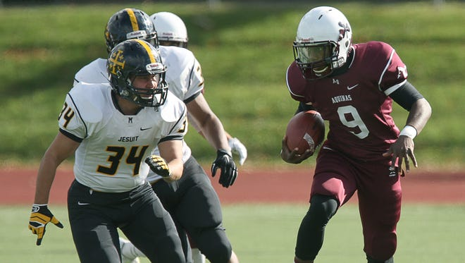 Earnest Edwards, shown here during a game versus McQuaid in 2014, should be a part of a high-scoring Aquinas offense.