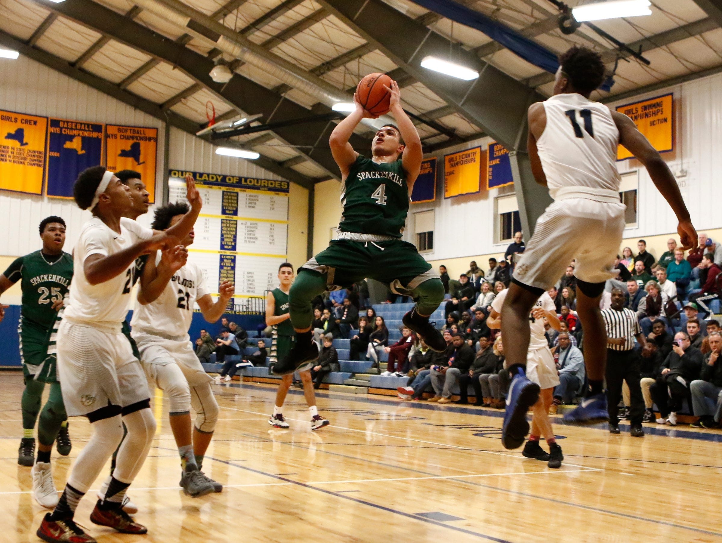 Spackenkill's Camron Abalos (4) puts up a shot in the championship game against Beacon in the Duane Davis memorial basketball tournament at Our Lady of Lourdes High School in Poughkeepsie on Saturday, December 31, 2016.