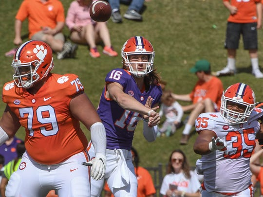 Clemson quarterback Trevor Lawrence (16) passes near offensive lineman Jackson Carman (79) during the 3rd quarter of the spring game in Memorial Stadium in Clemson on Saturday, April 14, 2018.