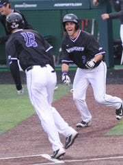 ACU's Derek Scott, right, celebrates with former Abilene High teammate Mark Pearson after Pearson scores the game-winning run on Dalon Farkas' double in the bottom of the 10th inning. The Wildcats beat Creighton 8-7 on Saturday, March 4, 2017 at Crutcher Scott Field for their sixth consecutive victory.