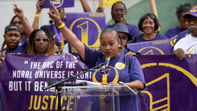 Kris Sherman-Burns, 56, who works as a janitor at Little Caesars Arena, talks about the importance of a $15-an-hour wage at an SEIU Local 1 janitors press conference and rally in Detroit Tuesday.