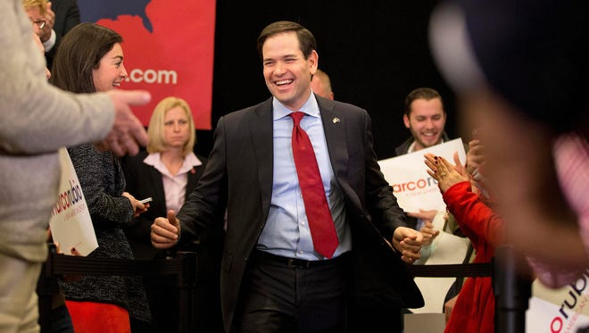 Republican presidential candidate, Sen. Marco Rubio, R-Fla. takes the stage for a rally, Friday, Feb. 19, 2016, in Columbia, S.C. An election watchdog organization filed a complaint Friday with the Federal Election Commission over a $500,000 donation to a super political action committee aiding Marco Rubio from a mystery firm headed by a New York investor. Efforts by good government groups to stem the use of shadowy corporate entities to channel large political donations have been long stymied by the FEC's internal political paralysis. (AP Photo/John Bazemore)