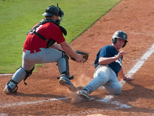 South catcher Brady Johnson, Jr., loses the ball as North baserunner Graham Ashcraft slides safely into home in game one of the AHSAA All-Star Sports Week at Riverwalk Stadium Montgomery, Ala. on Tuesday July 21, 2015.