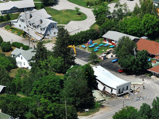 The Pioneer Store at Wisconsin 42 and Cedar Shore Road in Ellison Bay, bottom right, lies in ruins following an explosion on July 10, 2006. At upper left is the Cedar Grove inn on Cedar Shore Road that also collapsed.