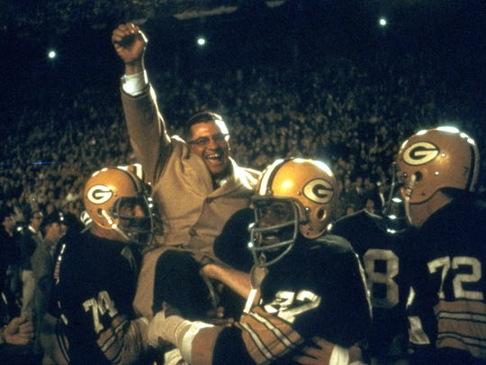 Coach Vince Lombardi is carried off the field after