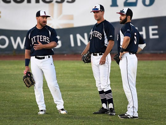 Evansville Otters outfielders (L-R) John  Schultz, Brandon Soat and Jeff Gardner talk during a break in the action as the Otters play the Windy City Thunderbolts at Bosse Field Wednesday, June 7, 2017.
