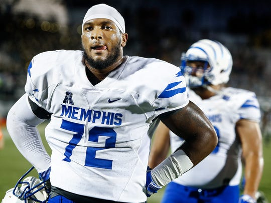 Dejected University of Memphis offensive lineman Trevon Tate walks off the field after falling to University of Central Florida 40-13 in Orlando, Fl., Saturday, September 30, 2017.