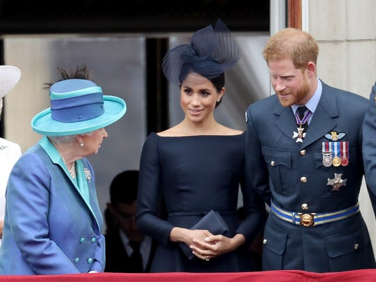 Queen Elizabeth II chats with Duchess Meghan of Sussex