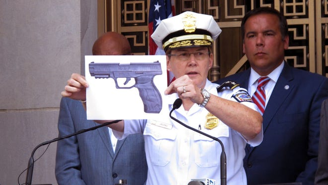 In this Thursday, Sept. 15, 2016, file photo, Columbus, Ohio, Police Chief Kim Jacobs displays a photo of the type of BB gun police say Tyre King pulled from his waistband before he was shot and killed by a police officer investigating an armed robbery report, during a news conference in Columbus, Ohio. As Ohio authorities investigate the fatal police shooting, law enforcement agencies are grappling with suspects' use of fake guns to commit real crimes. Some police departments say they've noticed an uptick in replicas.