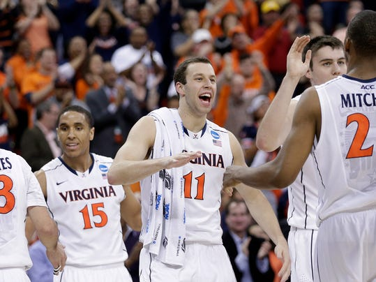 Virginia players celebrate at halftime in the first half of an NCAA college basketball third-round tournament game against Memphis, Sunday, March 23, 2014, in Raleigh. (AP Photo/Chuck Burton)