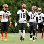 Bengals wide receivers (from left) Marvin Jones, A.J. Green, Denarius Moore and Brandon Tate take the practice field at Paul Brown Stadium on Tuesday for OTAs.