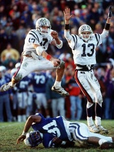 Eric Schaeb, l, and Mike Groh celebrate as Groh's 37-yard, game-winning field goal. (Daily Record file photo by Bob Karp)