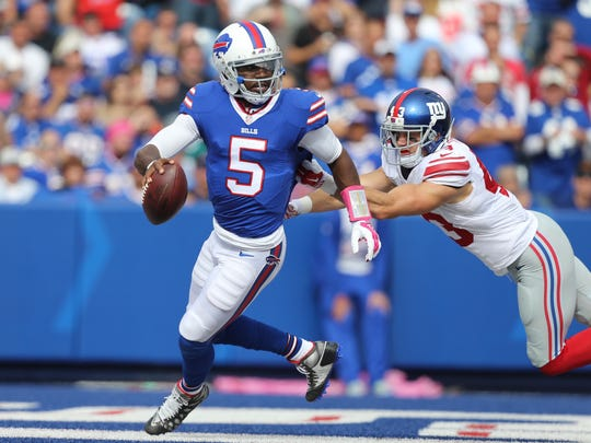 Tyrod Taylor tries to escape pressure in the end zone from Giants safety Craig Dahl.