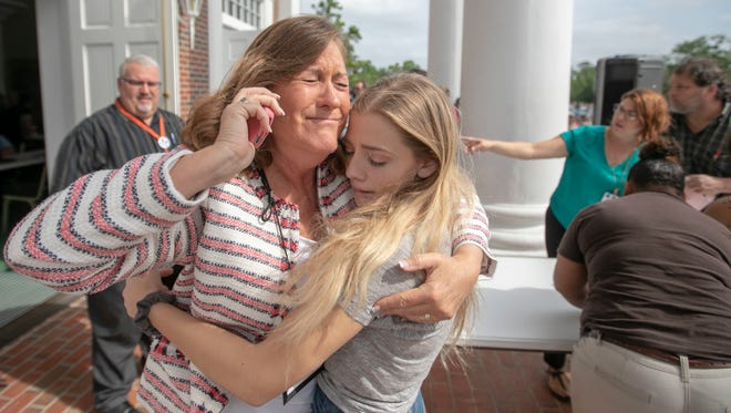Judge Sarah Ritterhoff Williams embraces family friend student Attie French after finding her in the crowd at First Baptist Church while looking for her own daughter following a shooting at Forest High School, on April 20, 2018 in Ocala, Fla.