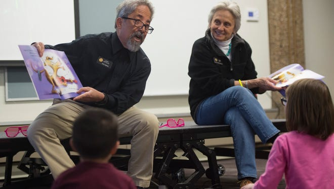State Sen. John Kefalas and Rep. Joann Ginal read to children during a program at Old Town Library on Saturday, April 14, 2018.