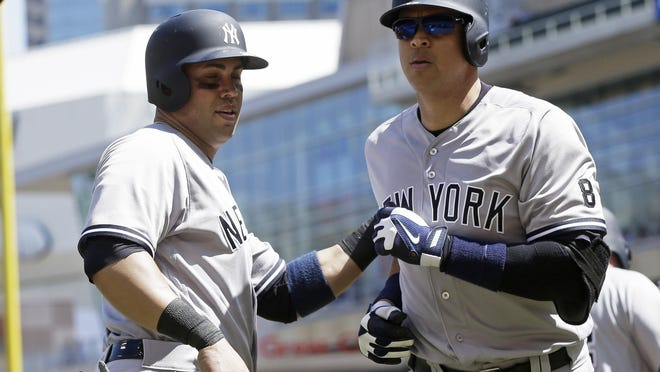 The New York Yankees' Alex Rodriguez, right, gets congratulations from Carlos Beltran following his two-run home run off Minnesota Twins pitcher Ricky Nolasco in the seventh inning Saturday in Minneapolis. Beltran followed with a two-run homer in the eighth inning.