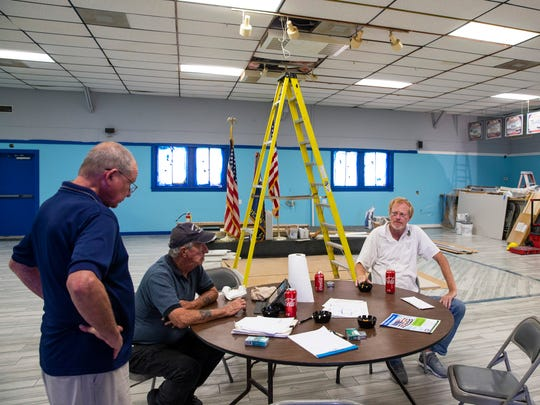 From right: John Madsen, Ed Bowling and Mickey Schuh discuss renovations at American Legion Hardee R. Mills Post 135 in East Naples on Thursday, May 31, 2018.