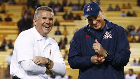 ASU coach Todd Graham talks with Arizona's Rich Rodriguez before the 2013 Territorial Cup.