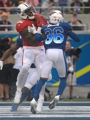 AFC tight end Delanie Walker (82) of the Titans grabs a touchdown pass over NFC safety Budda Baker (36) of the Cardinals during the second half of the Pro Bowl on Sunday.