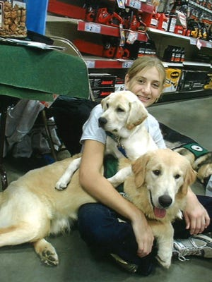 Kathryn Chenaille, a member of the Franklin County 4-H Seeing Eye Puppy Club, volunteers her time in the community throughout the year.