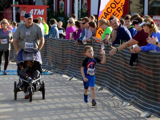 Runners make there way to the finish line Saturday during the Pensacola Beach Run Half Marathon,10k &5k.