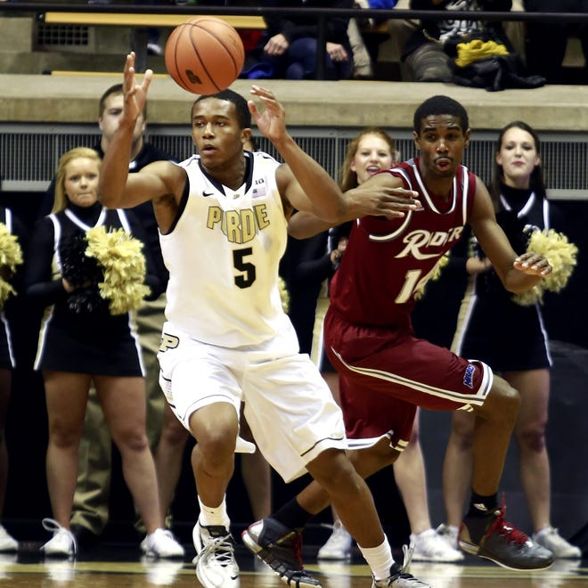 Purdue forward Basil Smotherman (5) reaches for the basketball pursued by Rider forward Shawn Valentine in the first half of an NCAA basketball game in West Lafayette, Sunday, Nov. 17, 2013. Purdue won 81-77. (AP Photo/R Brent Smith)