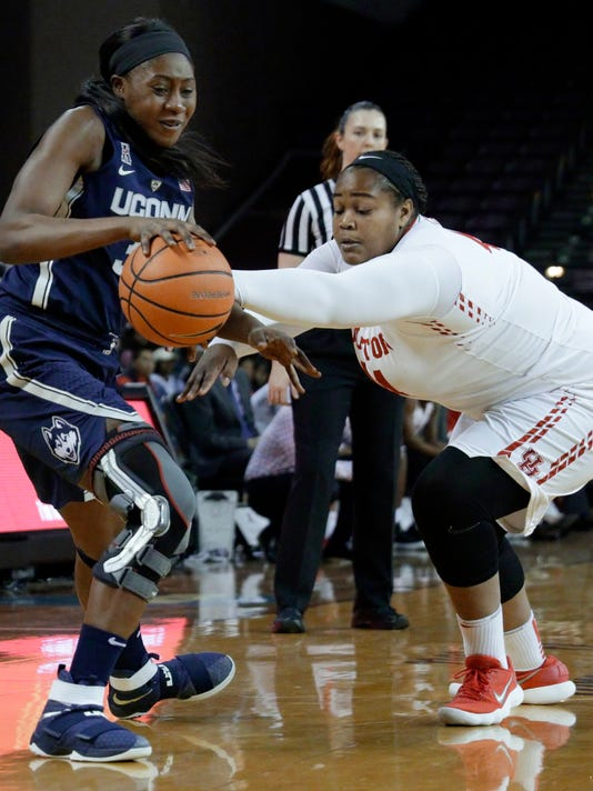 Connecticut forward Batouly Camara (32) avoids the steal from Houston forward Kaila Chizer (44) during the second half of an NCAA college basketball game Saturday, Jan. 13, 2018, in Houston, Texas. (AP Photo/Michael Wyke)