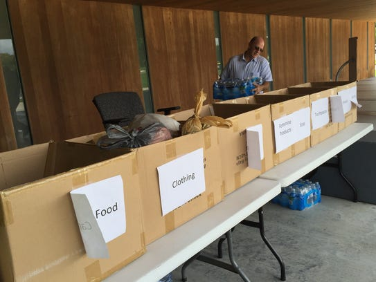 Stephen Broussard of Waitrs sorts donations for flood