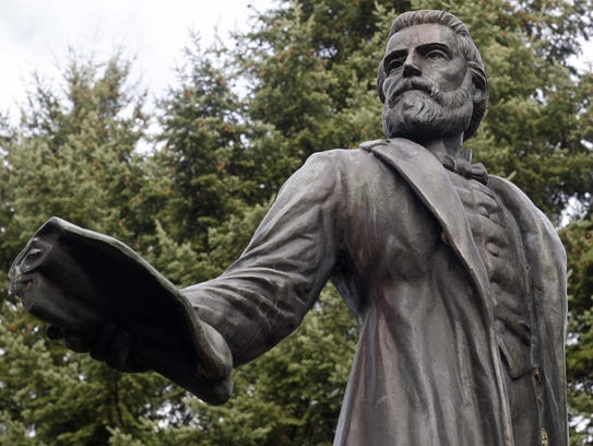 The statue of Salem founder Jason Lee is on display