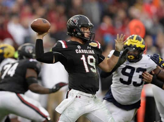 FILE - In this Jan. 1, 2018, file photo, South Carolina quarterback Jake Bentley throws a pass against Michigan during the second half of the Outback Bowl NCAA college football game, in Tampa, Fla. New South Carolina quarterbacks coach Dan Werner was brought on by South Carolina coach Will Muschamp to help ignite an offense that's been near the bottom of the Southeastern Conference the past two seasons. So far, so good, according to two-year starter Jake Bentley. (AP Photo/Chris O'Meara, File)