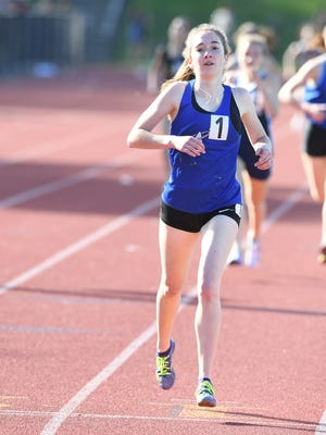 First day of Bergen County Track Championships at Old Tappan High School on Friday, May 11, 2018. Mackenzie Hughes, of Academy Of The Holy Angel, on her way to finishing first in her division of the 1600M.